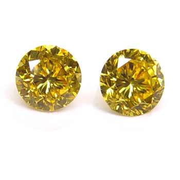 View 0.81 ct. Round Fancy Vivid o. Yellow (Pair)