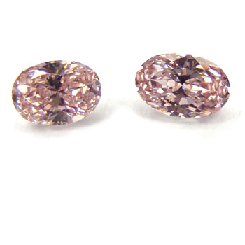 View 0.69 ct. Oval Fancy Orangy Pink (Pair)