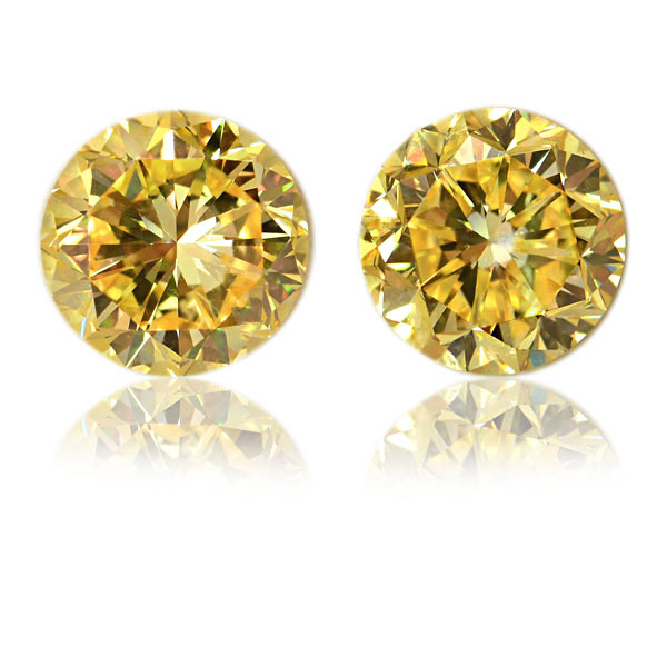 View 4.34 ct. Round Fancy VIVID Yellow (Flawless, Pair)