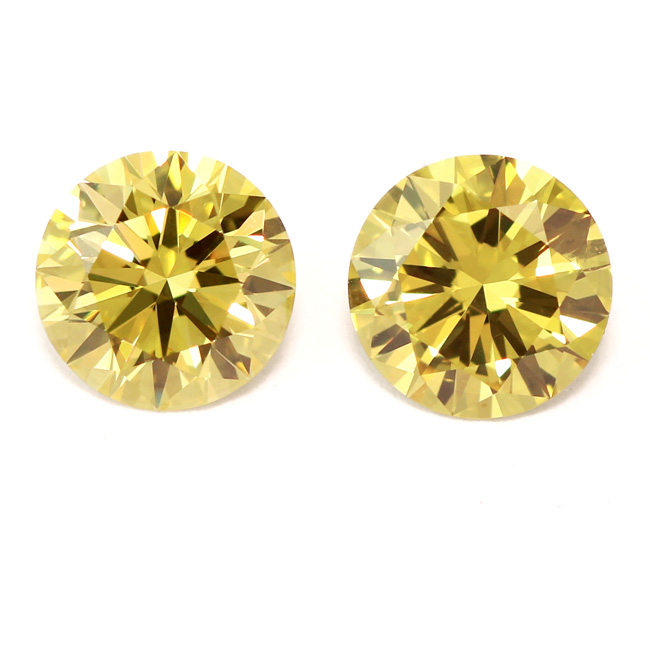 View 2.04 ct. Round Fancy Intense Yellow (Pair)